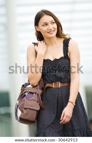 young pretty caucasian lady walking outdoor with confidence - stock photo
