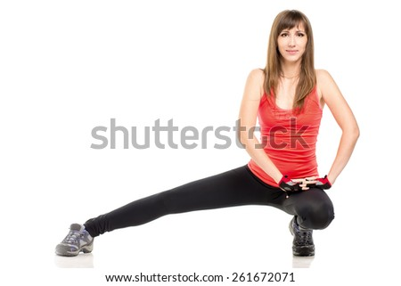 Young pretty caucasian woman stretching on floor. Fitness girl exercising isolated on white background - stock photo