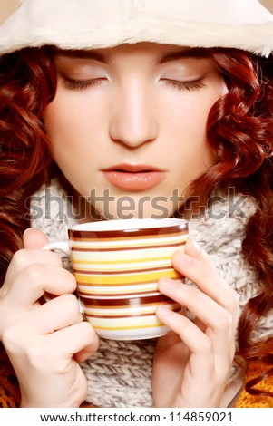 young pretty curly woman drinking coffee - stock photo