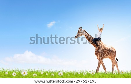 Young pretty fearless woman riding giraffe animal