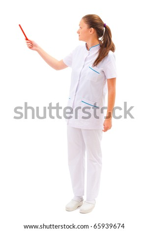 Young pretty female doctor smiling and pointing at copyspace isolated on white - stock photo