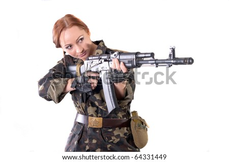 Young pretty female model in military outfit with AK-74 (Kalashnikov) assault rifle in studio