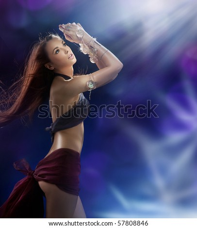 Young pretty girl dancing in a nightclub - stock photo
