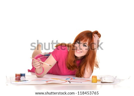young pretty girl drawing on the floor - stock photo