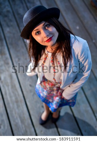 Young pretty girl elegantly dressed posing. Cute Caucasian model.