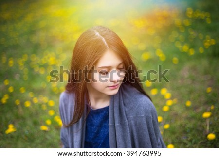 Young pretty girl enjoy spring park. Relax picture - stock photo