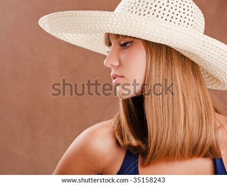 Young pretty girl in a straw hat