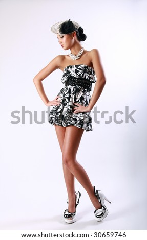 Young pretty girl in a vintage black and white dress - stock photo