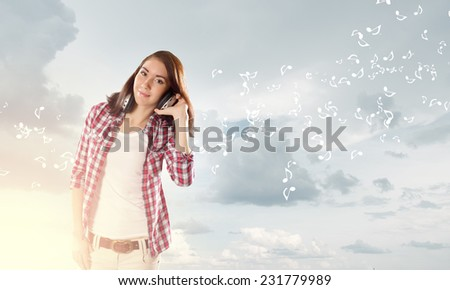 Young pretty girl in casual with headphones listen to music