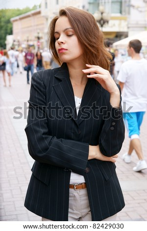 Young pretty girl in hat in the street - stock photo