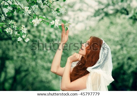 Young pretty girl in the garden - stock photo