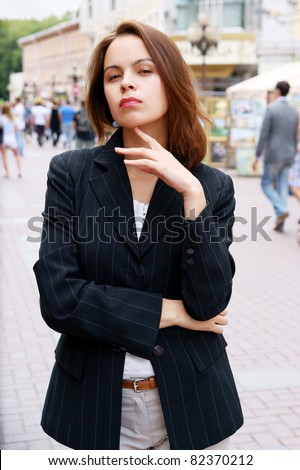 Young pretty girl in the street - stock photo