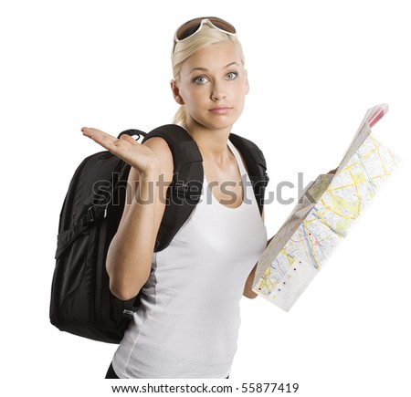 young pretty girl in vacation with map and rucksack looking in camera with funny expression - stock photo