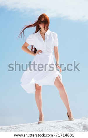 Young pretty girl in white dress - stock photo
