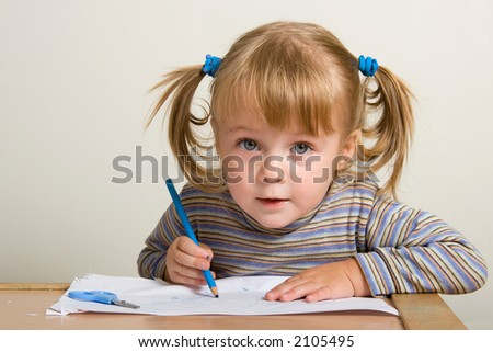 young pretty girl learn drawing with blue pen - stock photo