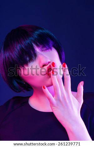Young pretty girl licking her finger portrait - stock photo