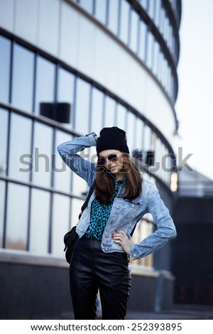 young pretty girl near business building walking, student in america - stock photo