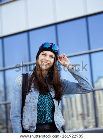 young pretty girl near business building walking, student in america or europe - stock photo