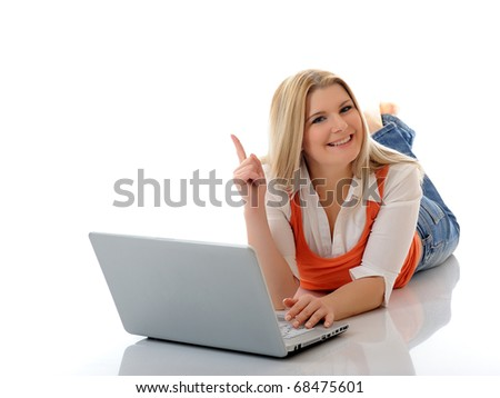 Young pretty girl networking on laptop computer in internet. isolated on white background