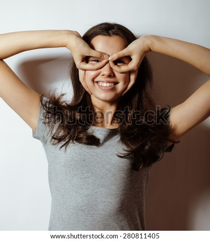 young pretty girl on white background gesturing adorable close up - stock photo