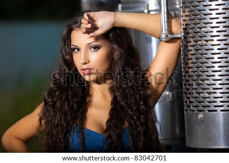 Young pretty girl portrait near steel truck - stock photo