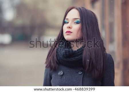 young pretty girl posing in the street, hipster style, outdoor portrait, black, fashion