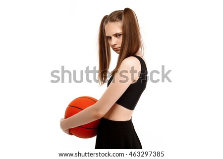 Young pretty girl posing with basketball, isolated on white background.
