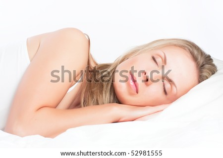 Young pretty girl sleeping on pillow. Sweet dreams - stock photo
