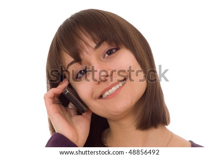 young pretty girl standing with a phone on a white background