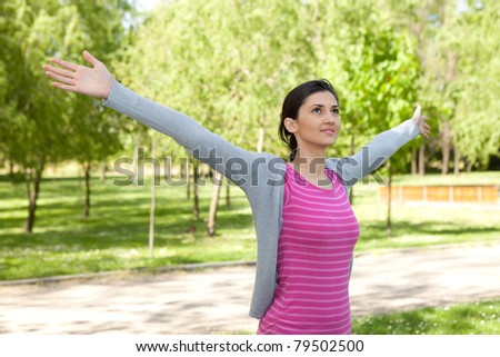 young pretty girl stretching outside - stock photo