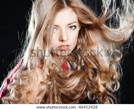 Young pretty girl with blonde hair portrait - stock photo