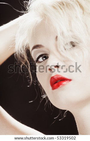 Young pretty girl with blonde hair portrait