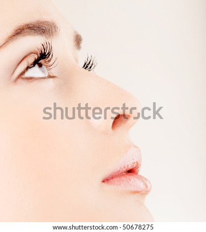 Young pretty girl with open mouth profile - stock photo