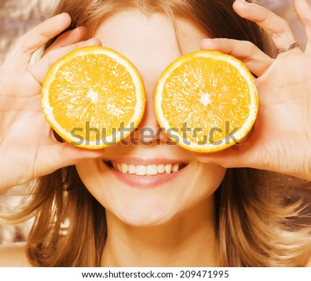 young pretty girl with orange close up - stock photo