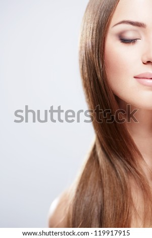 Young pretty girl with shiny hair - stock photo