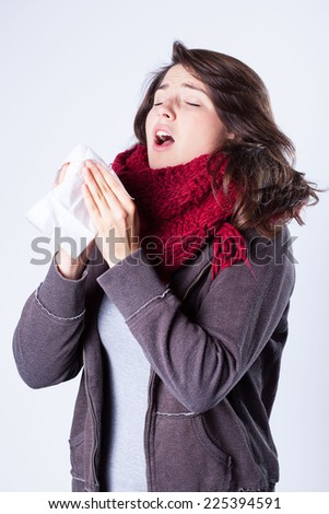 Young pretty girl with winter cold - stock photo