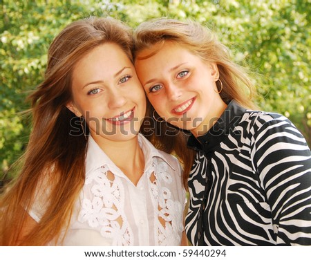 young pretty girlfrieds over nature background - stock photo