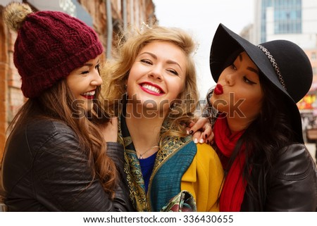 Young pretty  girls best friends smiling and having  fun, walking at the city. Shopping.  Wearing stylish outerwear. Bright make up. Positive emotions. Outdoors lifestyle fashion close up portrait  - stock photo