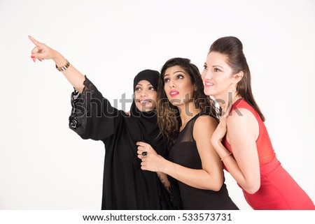 young pretty girls indexing and looking on white background