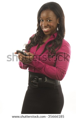 young pretty hispanic latina texting with handheld personal device cell phone - stock photo