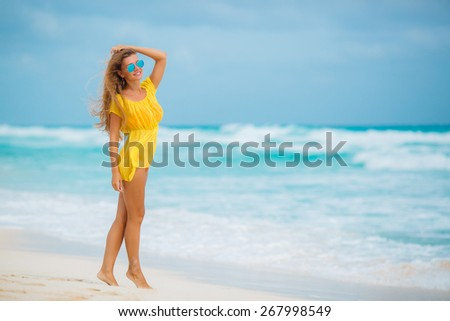Young pretty hot sexy woman on the tropic island in summer near the sea and blue sky having fun. Young caucasian woman near ocean beach - stock photo