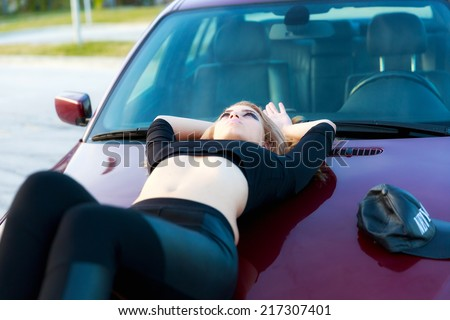 Young pretty lady with a clasic car - stock photo