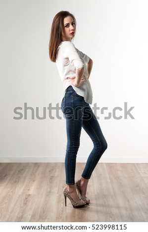 Young pretty model woman posing in studio