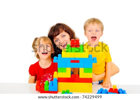 Young pretty mom is playing with her children - stock photo