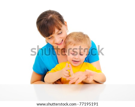 Young pretty mom is teaching son to coun - stock photo