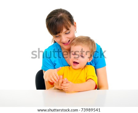 Young pretty mom is teaching son to count - stock photo