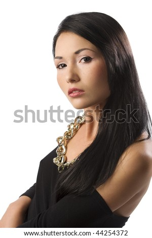 young pretty oriental woman with long black hair and a necklace in a fashion shot - stock photo