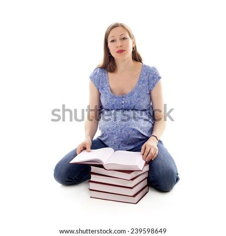 young pretty pregnant woman reading books