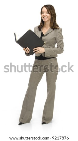 Young, pretty, professional woman standing with notebook on a white background