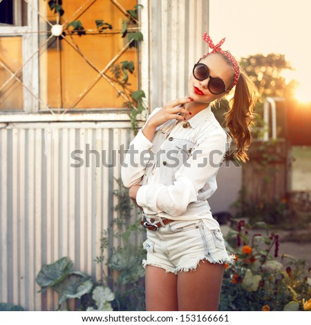 Young pretty red lips young girl posing outdoor in summer near sunlight and flowers - stock photo